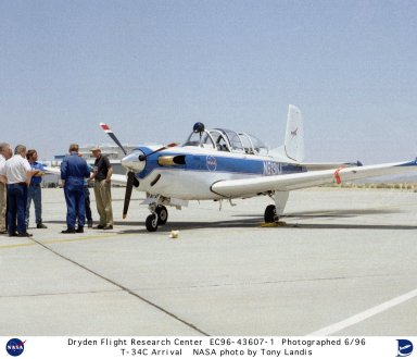 A NASA T-34C aircraft, used for safety chase, is viewed by personnel on the ramp at the Dryden Flight Research Center, Edwards, California, after its arrival in June of 1996. The aircraft was previously used at the Lewis Research Center in propulsion experiments involving turboprop engines, and was used as a chase aircraft at Dryden for smaller and slower research projects. Chase aircraft accompany research flights for photography and video purposes, and also as support for safety and research. At Dryden, the T-34 is used mainly for smaller remotely piloted vehicles which fly slower than NASA's F-18's, used for larger scale projects. This aircraft was returned to the U.S. Navy in May of 2002. The T-34C, built by Beech, carries a crew of 2 and is nicknamed the Mentor.
