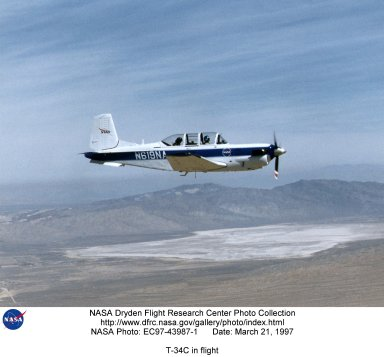 A NASA T-34C aircraft, used for safety chase, is shown flying above the Dryden Flight Research Center, Edwards, California in March 1997. The aircraft was previously used at the Lewis Research Center in propulsion experiments involving turboprop engines, and was used as a chase aircraft at Dryden for smaller and slower research projects. Chase aircraft accompany research flights for photography and video purposes, and also as support for safety and research. At Dryden, the T-34 is used mainly for smaller remotely piloted vehicles which fly slower than NASA's F-18's, used for larger scale projects. This aircraft was returned to the U.S. Navy in May of 2002. The T-34C, built by Beech, carries a crew of 2 and is nicknamed the Mentor.