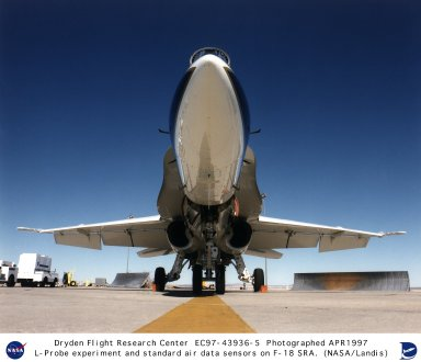 This under-the-nose view of a modified F-18 Systems Research Aircraft at NASA's Dryden Flight Research Center, Edwards, California, shows three critical components of the aircraft's air data systems which are mounted on both sides of the forward fuselage. Furthest forward are two L-probes that were the focus of the recent Advanced L-probe Air Data Integration (ALADIN) experiment. Behind the L-probes are angle-of-attack vanes, while below them are the aircraft's standard pitot-static air data probes. The ALADIN experiment focused on providing pilots with angle-of-attack and angle-of-sideslip air data as well as traditional airspeed and altitude information, all from a single system. Once fully developed, the new L-probes have the potential to give pilots more accurate air data information with less hardware.