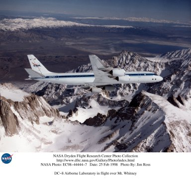 The DC-8 banking over the jagged peak of Mount Whitney on a February 25, 1998 flight. The DC-8 and a pair of ER-2 aircraft are operated by the Airborne Science program at the NASA Dryden Flight Research Center. NASA, other governmental agencies, academia, and scientific and technical organizations employ the DC-8 for a variety of experiments.
