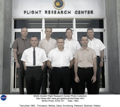 A group photo of NASA research pilots at the front door of the Flight Research Center headquarters building. In the front row are (left to right) Milt Thompson, Jack McKay, and Bill Dana. All three flew the X-15, and Thompson and Dana were also involved in the lifting body flights. McKay was injured in a crash landing in X-15 #2. Although he recovered, the injuries eventually forced him to retire from research flying. In the back row (left to right) are Neil Armstrong, Bruce Peterson, Stanley Butchart, and Joe Walker. Armstrong and Walker also both flew the X-15. Soon after this photo was taken, Armstrong was selected as an astronaut, and seven years later became the first man to walk on the Moon. Walker made the highest flight in the X-15, reaching 354,200 feet. He then went on to fly the Lunar Landing Research Vehicle, and was killed on June 8, 1966 when his F-104N collided with the XB-70. Peterson made the first flight in the HL-10 lifting body, and was later badly injured in the crash of the M2-F2 lifting body. Butchart flew a wide range of research missions in the 1950s, and was the B-29 drop plane pilot for a number of rocket flight.