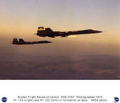 """The YF-12A (60-6935) carries the """"coldwall"""" heat transfer pod on a pylon beneath the forward fuselage. The pod is seen with its insulating coating intact. In the background, the YF-12C flies photo chase. The coldwall project, supported by Langley Research Center, consisted of a stainless steel tube equipped with thermocouples and pressure-sensors. A special insulating coating covered the tube, which was chilled with liquid nitrogen. At Mach 3, the insulation could be pyrotechnically blown away from the tube, instantly exposing it to the thermal environment. The experiment caused many inflight difficulties, such as engine unstarts, but eventually researchers got a successful flight. The Flight Research Center's involvement with the YF-12A, an interceptor version of the Lockheed A-12, began in 1967. Ames Research Center was interested in using wind tunnel data that had been generated at Ames under extreme secrecy. Also, the Office of Advanced Research and Technology (OART) saw the YF-12A as a means to advance high-speed technology, which would help in designing the Supersonic Transport (SST). The Air Force needed technical assistance to get the latest reconnaissance version of the A-12 family, the SR-71A, fully operational. Eventually, the Air Force offered NASA the use of two YF-12A aircraft, 60-6935 and 60-6936. A joint NASA-USAF program was mapped out in June 1969. NASA and Air Force technicians spent three months readying 935 for flight. On 11 December 1969, the flight program got underway with a successful maiden flight piloted by Col. Joe Rogers and Maj. Gary Heidelbaugh of the SR-71/F-12 Test Force. During the program, the Air Force concentrated on military applications, and NASA pursued a loads research program. NASA studies included inflight heating, skin-friction cooling, """"coldwall"""" research (a heat transfer experiment), flowfield studies, shaker vane research, and tests in support of the Space Shuttle landing program. Ultimately, 935 became the workhorse of"""