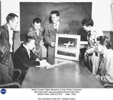 """NACA Muroc Flight Test Unit XS-1 Team members and USAF Pilots. From Left to Right: Joseph Vensel, Head of Operations; Gerald Truszynski, Head of Instrumentation; Captain Charles """"Chuck"""" Yeager, USAF pilot; Walter Williams, Head of the Unit; Major Jack Ridley, USAF pilot; and De E. Beeler, Head of Engineers. (1947)"""