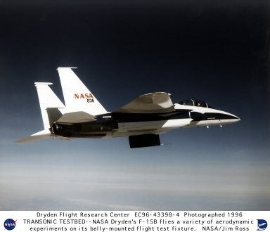 NASA's Dryden Flight Research Center, Edwards, California, is using a modified McDonnell-Douglas F-15B aircraft as a testbed for a variety of transonic flight experiments. The twin-engine, twin-tail aircraft is shown carrying a Dryden-designed Flight Test Fixture (FTF) upon which aerodynamic experiments are mounted. The F-15B flew several flights recently in support of an experiment to determine the precise location of of sonic shock wave development as air passes over an airfoil. The F-15B is currently being prepared for the Boundary Layer Heat Experiment, which will explore potential aerodynamic drag reduction from heating the turbulent portion of the air flow that passes over the fuselage of a large aircraft. The experiment also will measure the amount of electrical power required to achieve the expected heat-induced reduction in aerodynamic drag. Six thin electric resistance heaters well be mounted in the FTF, and both unheated and heated temperatures as well as surface air pressures will be measured.
