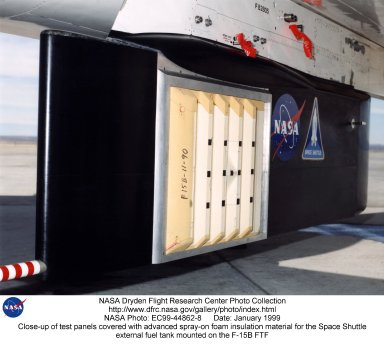 Test panels covered with an advanced foam insulation material for the Space Shuttle's giant external fuel tank were test flown aboard an F-15B research aircraft at NASA's Dryden Flight Research Center, Edwards, Calif. Six panels were mounted on the left side of a heavily instrumented Flight Text Fixture mounted underneath the F-15B's fuselage. Insulation on this panel was finely machined over a horizontal rib structure to simulate in-line airflow past the tank; other panels had the ribs mounted vertically or had the insulation left in a rough as-sprayed surface. The tests were part of an effort by NASA's Marshall Space Flight Center to determine why small particles of the new insulation flaked off the tank on recent Shuttle missions. The tests with Dryden's F-15B were designed to replicate the pressure environment the Shuttle encounters during the first minute after launch. No noticeable erosion of the insulation material was noted after the flight experiment at Dryden.
