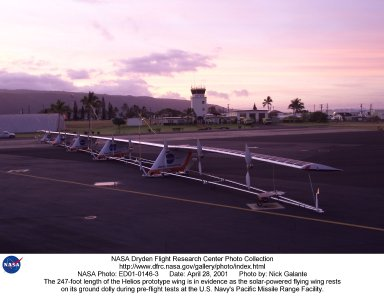 The 247-foot length of the Helios prototype wing is in evidence as the high-altitude, solar-powered flying wing rests on its ground dolly during pre-flight tests at the U.S. Navy's Pacific Missile Range Facility on Kaua'i, Hawaii.
