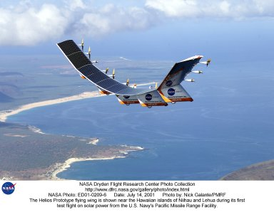 The solar-electric Helios Prototype flying wing is shown near the Hawaiian islands of Niihau and Lehua during its first test flight on solar power from the U.S. Navy's Pacific Missile Range Facility on Kauai, Hawaii, July 14, 2001. The 18-hour flight was a functional checkout of the aircraft's systems and performance in preparation for an attempt to reach sustained flight at 100,000 feet altitude later this summer.