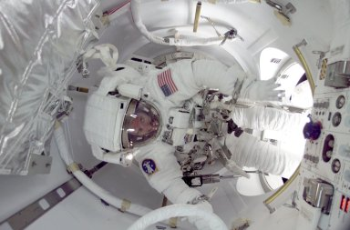 STS-104 Onboard Photograph-Astronaut in the ISS Airlock
