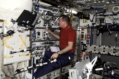 Astronaut James S. Voss Performs Tasks in the Destiny Laboratory