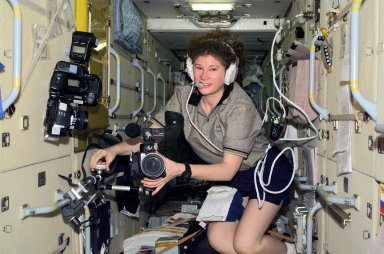 Astronaut Susan J. Helms Mounts a Videao Camera in Zarya
