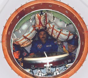 Expedition-8 Flight Members Pose Inside the Soyuz TMA-3 Vehicle