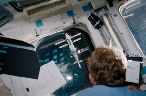 STS-102 Astronaut Thomas Views International Space Station Through Shuttle Window