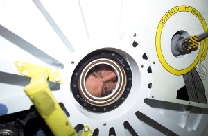 Astronaut Voss Peers Into Pressurized Mating Adapter (PMA)