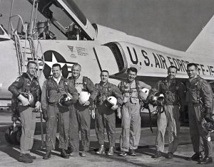 The Original Seven Astronauts in Front of an Air Force Jet