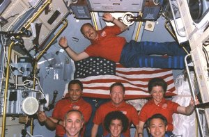 Onboard photo: STS-50 crew portrait with American flag