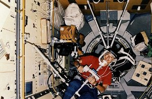 Onboard photo: Japanese Payload Specialist Dr. Mamoru Mohri at work in Spacelab-J module