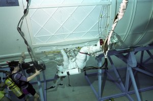 Jernigan and Wolf in Neutral Buoyancy Simulator (NBS)