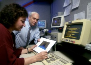 Dr. Fishman Reviewing Data From the Burst and Transient Source Experiment (BATSE)