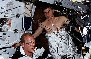 Onboard Photo: Astronauts Work With Lower Body Negative Pressure (LBNP)Apparatus