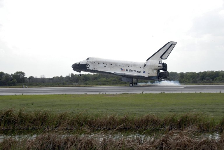 Discovery lands!