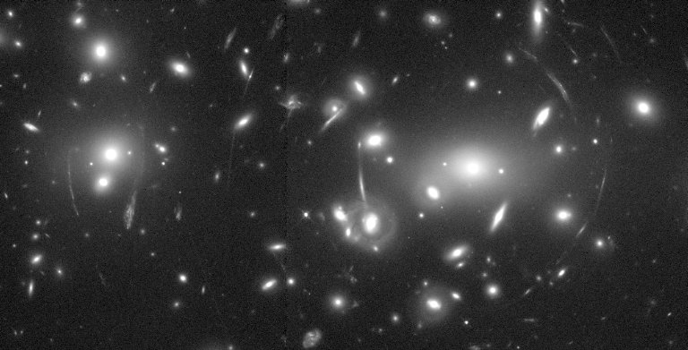 Hubble Views Distant Galaxies through a Cosmic Lens