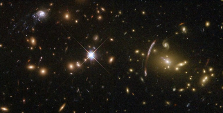 Hubble Sees 'Comet Galaxy' Being Ripped Apart By Galaxy Cluster