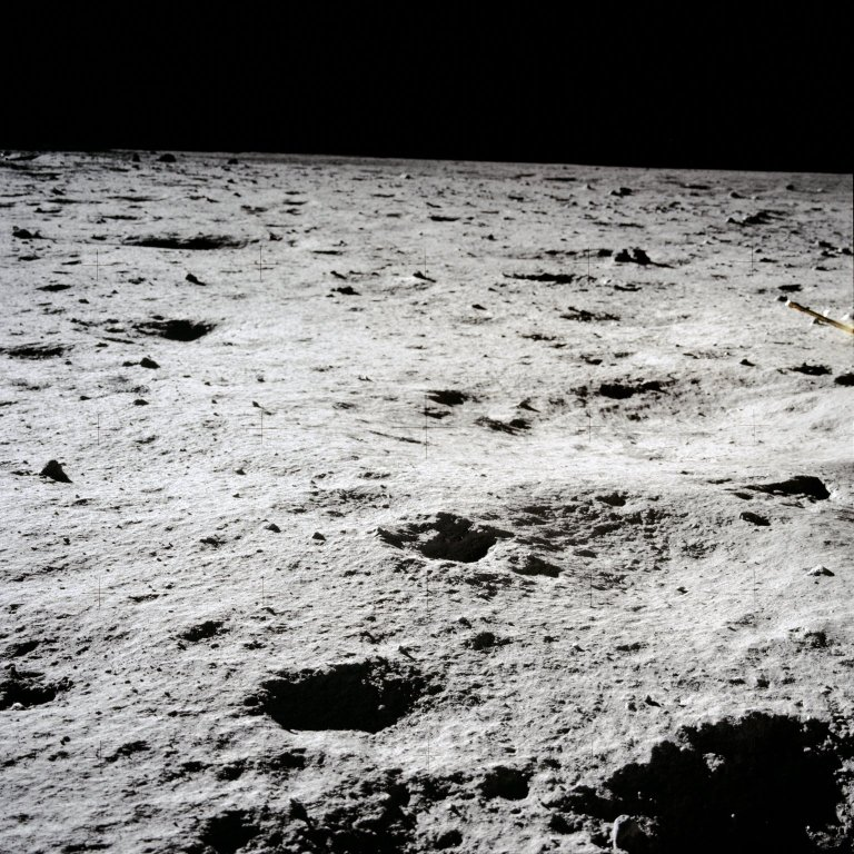 Apollo 11 Mission image - Lunar surface and horizon with shallow craters visible