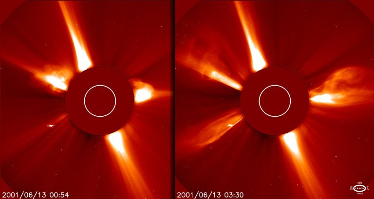 Images showing two, then three coronal mass ejections 13 June 2001 taken by LASCO C2 Joseph B. Gurman Normal Joseph B. Gurman 1 1 2001-06-13T15:46:00Z 2001-06-13T15:47:00Z 1 58 335 NASA GSGC 2 1 411 9.2511 800x600 0 0 Images showing two, then three coronal mass ejections 13 June 2001 taken by LASCO C2. Rarely has SOHO seen three CMEs in a LASCO C2 image because these blasts usually disappear from its field of view too quickly. CMEs eject a billion tons of particles traveling millions of miles an hour. The dark disk blocks the Sun so that the LASCO instrument can observe the structures of the corona in visible light.