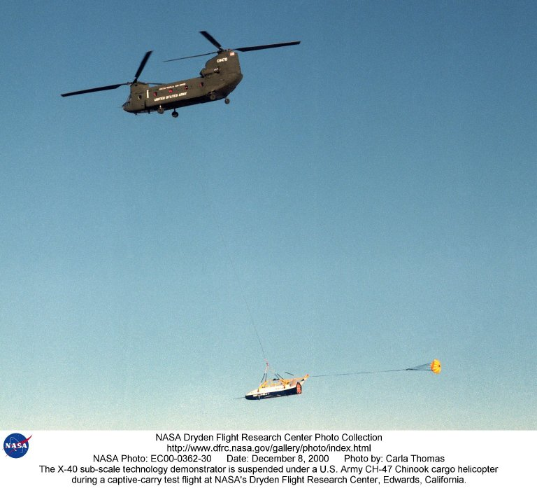 The X-40 sub-scale technology demonstrator is suspended under a U.S. Army CH-47 Chinook cargo helico
