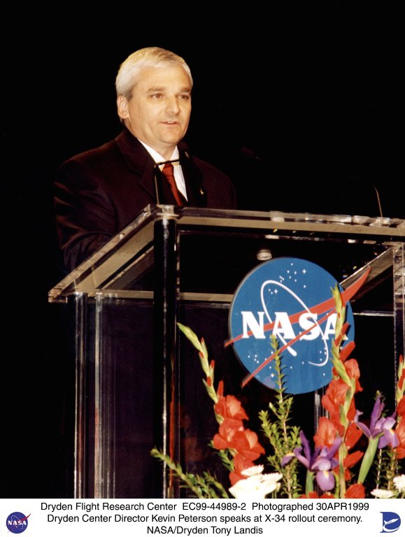 NASA Dryden Center Director Kevin Petersen speaking at the X-34 rollout ceremony April 30, 1999