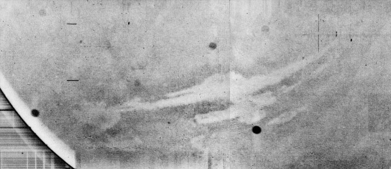 Mariner 9 views Canyon System emerging from Martian Dust Storm