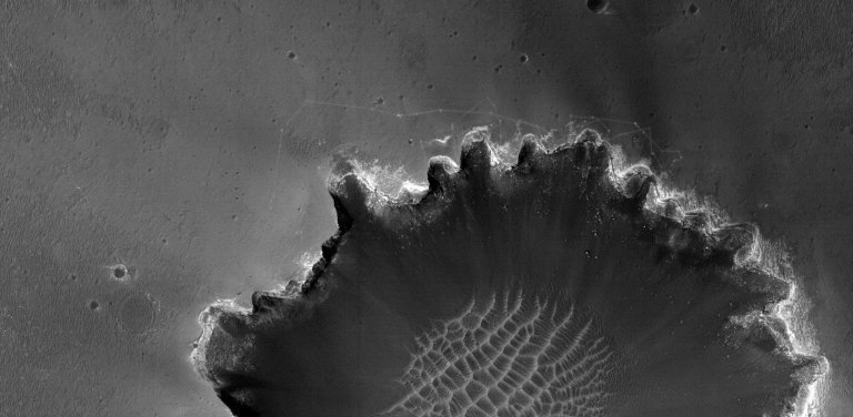 Rover Tracks at Crater's Edge