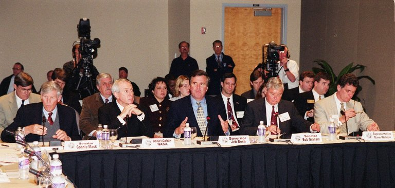 Participants in the First Florida Space Summit take part in a discussion on the future of space as it relates to the State of Florida. Held at the Kennedy Space Center Visitor Complex, the discussion was moderated by Center Director Roy Bridges. Seated (left to right) are Senator Connie Mack, NASA Administrator, Governor Jeb Bush, Senator Bob Graham and Representative Dave Weldon. The event also included 45th Space Wing Commander Brig. Gen. Donald Pettit and heads of aerospace companies