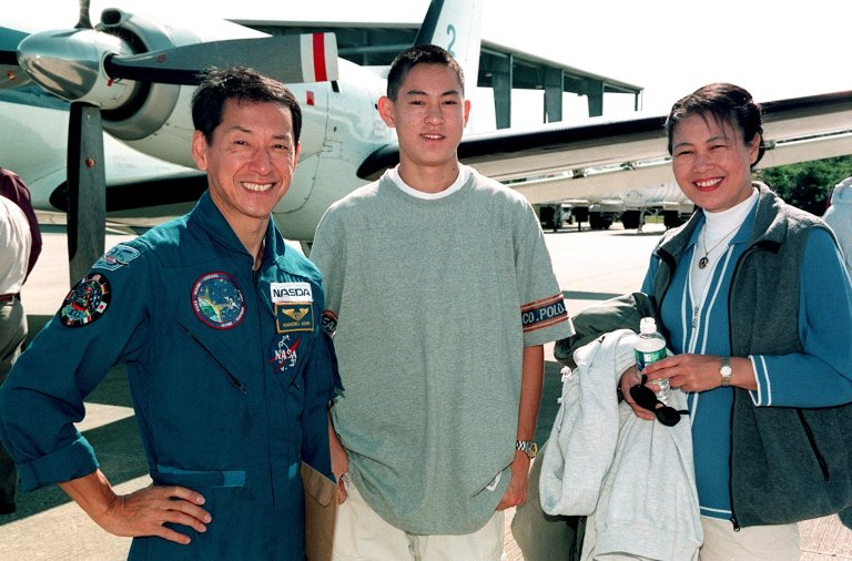 STS-99 Mission Specialist Mamoru Mohri (left) is joined by his son and wife, Akiko, at the Shuttle Landing Facility before their departure for Houston. The STS-99 crew completed a successful 11-day Shuttle Radar Topography Mission mapping 47 million square miles of the Earth's surface before landing at KSC Feb. 22
