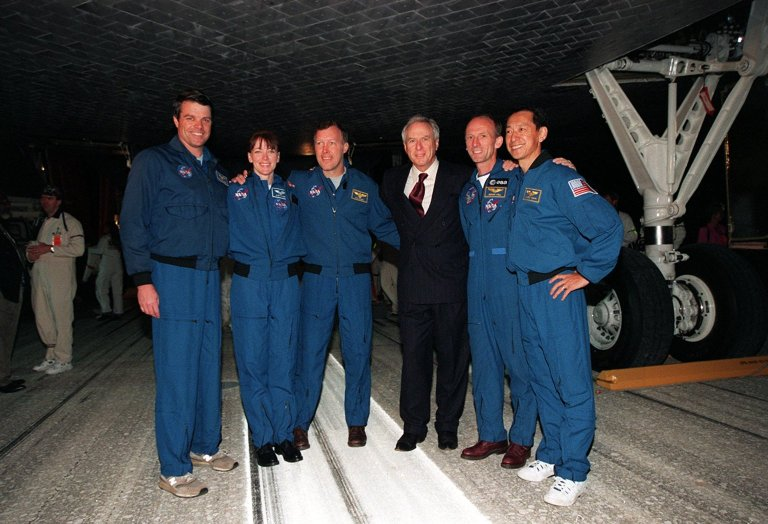 KENNEDY SPACE CENTER, FLA. -- Members of the STS-99 crew pose with NASA Administrator Dan Goldin underneath Space Shuttle Endeavour on KSC's Shuttle Landing Facility. From left are Commander Kevin Kregel, Mission Specialist Janet Kavandi, Pilot Dominic Gorie, Goldin, and Mission Specialists Gerhard Thiele and Mamoru Mohri. Not in the photo is Mission Specialist Janice Voss. Main gear touchdown was at 6:22:23 p.m. EST Feb. 22 , landing on orbit 181 of the mission. Nose gear touchdown was at 6:22:35 p.m.. EST, and wheel stop at 6:23:25 p.m. EST. The crew returned from the Shuttle Radar Topography Mission after mapping more than 47 million square miles of the Earth's surface. This was the 97th flight in the Space Shuttle program and the 14th for Endeavour, also marking the 50th landing at KSC, the 21st consecutive landing at KSC, and the 28th in the last 29 Shuttle flights