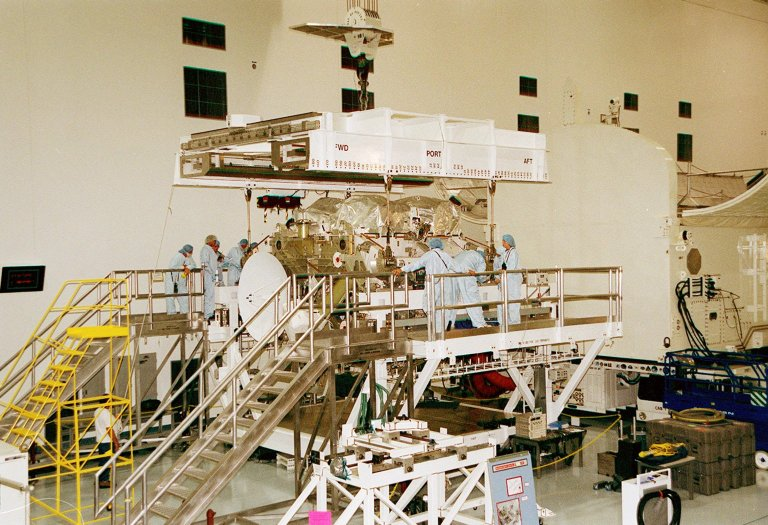 In the Space Station Processing Facility, an overhead crane is placed into position to lift the Integrated Truss Structure Z1, part of the backbone of the International Space Station. The truss, which is being moved to a payload canister for transport to Launch Pad 39A, is part of the payload on mission STS-92 scheduled to lift off Oct. 5, 2000