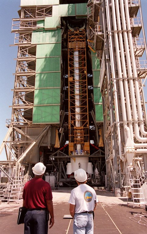 KENNEDY SPACE CENTER, Fla. -- The first (booster) stage of an Atlas II rocket is moved into the launch tower at Pad 36-A, Cape Canaveral Air Force Station. It will later be mated with the Tracking and Data Relay Satellite, known as TDRS-I, for launch in January 2002. The TDRS System (TDRSS) is a communication signal relay system that provides tracking and data acquisition services between low-Earth orbiting spacecraft and NASA/customer control and/or data processing facilities. The system is capable of transmitting to and receiving data from customer spacecrafts over 100 percent of their orbit (some limitations may apply depending on actual orbit). The TDRS-I provides a Ka-band service that will allow customers with extremely high data rates to be supported by the Tracking and Data Relay Satellite System (TDRSS) if they desire