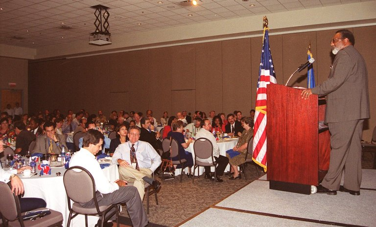 KENNEDY SPACE CENTER, Fla. -- Deputy Center Director Jim Jennings speaks to guests at the annual Hispanic Heritage Month Celebration, held at the Kurt Debus Conference Facility at KSC. Chaired by Rey N. Diaz and Maria Lopez-Tellado, who received plaques of appreciation for their efforts, the event also featured a luncheon and comments by Miguel Rodriquez, chief, Integration Office, of the Joint Performance Management Office. The pledge of allegiance and invocation was led by Joseph Tellado, International Space Station/Payload Processing. The Merrit Island High School ROTC provided the color guard. The event was sponsored by the Hispanic Employment Program Working Group at KSC