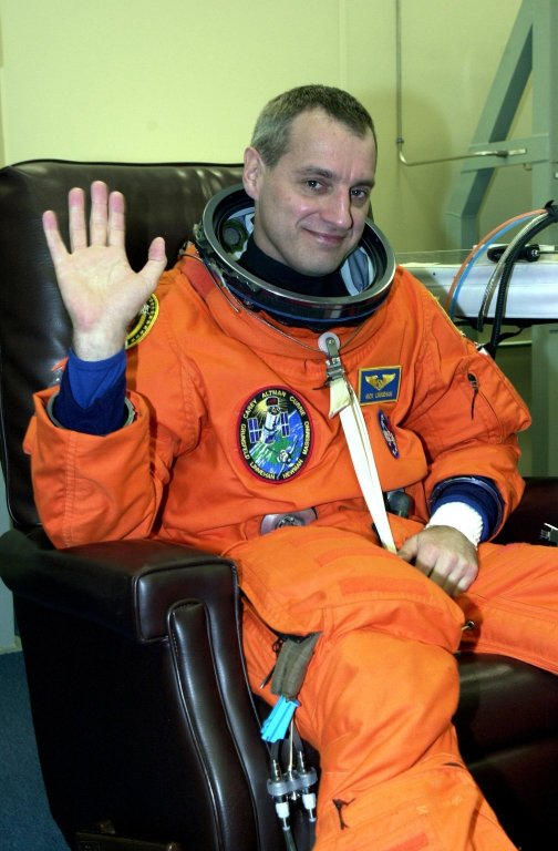 KENNEDY SPACE CENTER, Fla. - During suitup, STS-109 Mission Specialist Richard M. Linnehan shows he is ready for launch. Liftoff of Space Shuttle Columbia is scheduled for 6:22 a.m. EST March 1. On mission STS-109, the crew will capture the Hubble Space Telescope using the Shuttle's robotic arm and secure it on a workstand in Columbia's payload bay. Four mission specialists will perform five scheduled spacewalks to complete system upgrades to the telescope. More durable solar arrays, a large gyroscopic assembly to help point the telescope properly, a new telescope power control unit, and a cooling system to restore the use of a key infrared camera and spectrometer unit, which has been dormant since 1999, will all be installed. In addition, the telescope's view of the Universe will be improved with the addition of the Advanced Camera for Surveys (ACS), which replaces the Faint Object Camera, the last of Hubble's original instruments. Mission STS-109 is the 27th flight of the orbiter Columbia and the 108th flight overall in NASA's Space Shuttle program. After the 11-day mission, Columbia is scheduled to land about 4:35 a.m. EST March 12