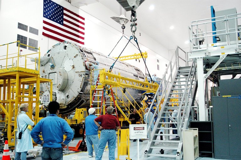 """KENNEDY SPACE CENTER, FLA. - In the Space Station Processing Facility, overhead cranes are removed from the Japanese Experiment Module (JEM) pressure module now on its work stand. A research laboratory, the pressurized module is the first element of the JEM, named """"Kibo"""" (Hope), to be delivered to KSC. The National Space Development Agency of Japan (NASDA) developed the laboratory at the Tsukuba Space Center near Tokyo and is Japan's primary contribution to the Station. It will enhance the unique research capabilities of the orbiting complex by providing an additional environment for astronauts to conduct science experiments. The JEM also includes an exposed facility (platform) for space environment experiments, a robotic manipulator system, and two logistics modules. The various JEM components will be assembled in space over the course of three Shuttle missions."""