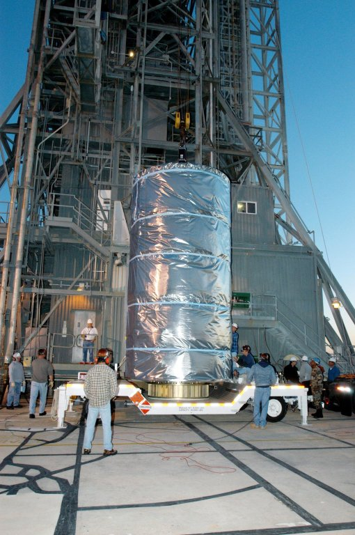 KENNEDY SPACE CENTER, FLA. - Wrapped inside a protective cover, the Swift spacecraft arrives at Launch Pad 17-A on Cape Canaveral Air Force Station in Florida. Swift is scheduled to launch Nov. 17. The liftoff aboard a Boeing Delta II rocket is targeted at the opening of a one-hour launch window beginning at 12:09 p.m. EST. A first-of-its-kind multi-wavelength observatory dedicated to the study of gamma-ray burst (GRB) science, Swift?s three instruments will work together to observe GRBs and afterglows in the gamma ray, X-ray, ultraviolet and optical wavebands. Gamma-ray bursts are distant, yet fleeting explosions that appear to signal the births of black holes.