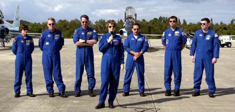 KENNEDY SPACE CENTER, FLA. - At the Shuttle Landing Facility, STS-114 Mission Commander Eileen Collins talks to reporters before the crew departs Kennedy Space Center. Behind Collins are, left to right, Mission Specialists Wendy Lawrence, Andrew Thomas, Stephen Robinson, Charles Camardo and Sochi Noguchi, and Pilot James Kelly. Noguchi is with the Japanese Space Agency. The crew was at KSC to observe the newly redesigned External Tank and new 50-foot-long Orbiter Boom Sensor System (OBSS). Among redesign changes on the ET is the forward bipod fitting to reduce the risk to the Shuttle from falling debris during ascent. A camera has also been added to capture separation of the ET from the Shuttle after launch. The OBSS attaches to the end of the Shuttle?s robotic arm and equips the orbiter with cameras and laser systems to inspect the Shuttle?s Thermal Protection System while in space. The launch window for Return to Flight mission STS-114 is May 12 to June 3, 2005. (Photo: Michael R. Brown)