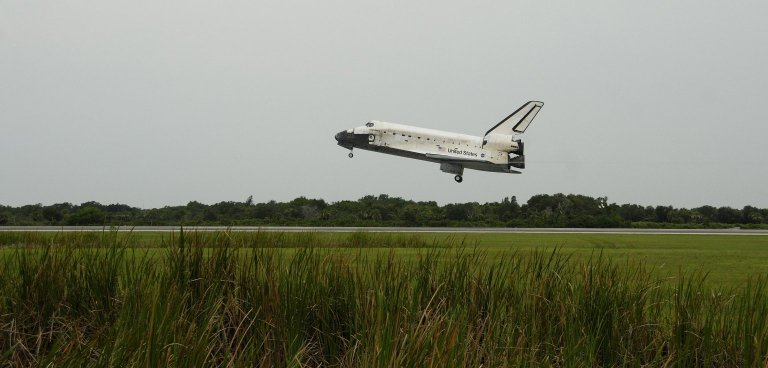 KENNEDY SPACE CENTER, FLA. - The orbiter Discovery, with Commander Steven Lindsey at the helm, approaches Runway 15 at NASA's Shuttle Landing Facility for landing after completing mission STS-121 to the International Space Station. Discovery traveled 5.3 million miles, landing on orbit 202. Mission elapsed time was 12 days, 18 hours, 37 minutes and 54 seconds. Main gear touchdown occurred on time at 9:14:43 EDT. Wheel stop was at 9:15:49 EDT. The rest of the crew aboard are Pilot Mark Kelly and Mission Specialists Piers Sellers, Michael Fossum, Lisa Nowak and Stephanie Wilson. Mission Specialist Thomas Reiter, who launched with the crew on July 4, remained on the station to join the Expedition 13 crew there. The landing is the 62nd at Kennedy Space Center and the 32nd for Discovery. Discovery's landing was as exhilarating as its launch, the first to take place on America's Independence Day. During the mission, the STS-121 crew tested new equipment and procedures to improve shuttle safety, and delivered supplies and made repairs to the International Space Station. Photo courtesy of Nikon/Scott Andrews