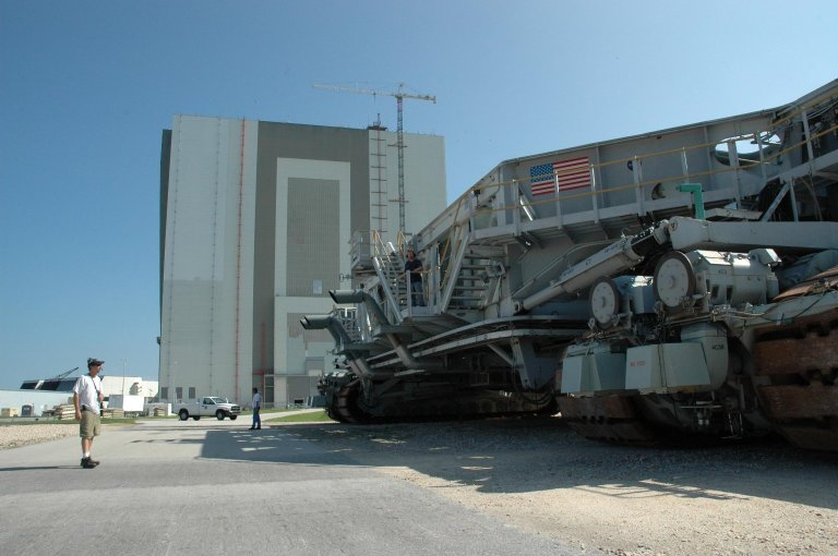 KENNEDY SPACE CENTER, FLA. - Crawler-transporter No. 1 sits outside the Vehicle Assembly Building. Workers will be driving the crawler to test it before it is needed to roll back Space Shuttle Atlantis from Launch Pad 39B. The rollback will be determined by the mission management team based on information about Hurricane Ernesto and its path through Florida. Atlantis has been poised on Launch Pad 39B for liftoff on mission STS-115 to the International Space Station to deliver the P3/P4 truss segment. Photo credit: NASA/Jack Pfaller