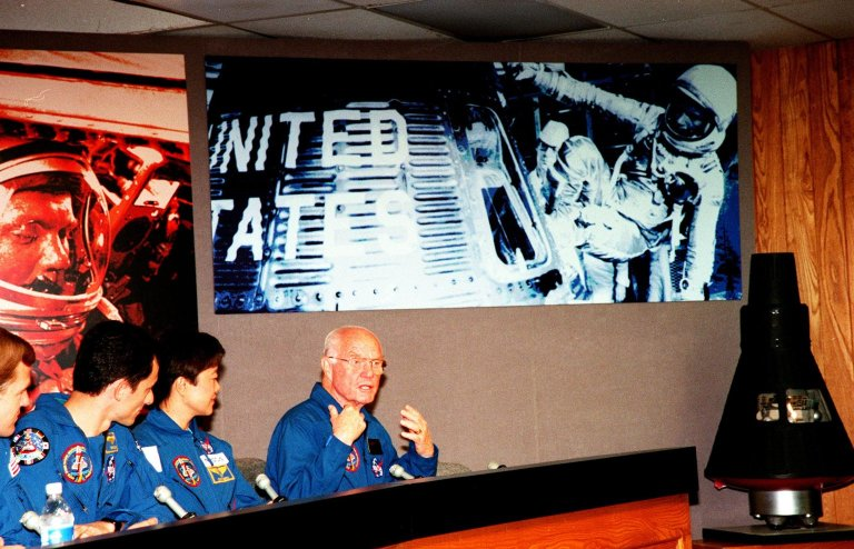 STS-95 Payload Specialist John H. Glenn Jr. (right), a senator from Ohio and one of the original seven Project Mercury astronauts, gestures during a media briefing at the Kennedy Space Center Press Site Auditorium. Glenn and the other members of the STS-95 crew held the briefing before returning to the Johnson Space Center in Houston, Texas. Others shown are (left to right) Mission Specialist Scott E. Parazynski; Mission Specialist Pedro Duque, with the European Space Agency (ESA); and Payload Specialist Chiaki Mukai, with the National Space Development Agency of Japan (NASDA). The other crew members participating in the briefing were Mission Commander Curtis L. Brown Jr., Pilot Steven W. Lindsey, and Mission Specialist and Payload Commander Stephen K. Robinson. The STS-95 mission ended with landing at Kennedy Space Center's Shuttle Landing Facility at 12:04 p.m. EST on Nov. 7. The mission included research payloads such as the Spartan-201 solar-observing deployable spacecraft, the Hubble Space Telescope Orbital Systems Test Platform, the International Extreme Ultraviolet Hitchhiker, as well as a SPACEHAB single module with experiments on space flight and the aging process