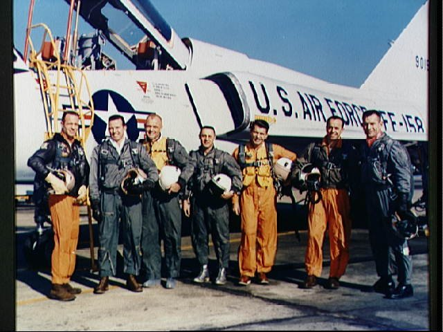 Mercury astronauts standing beside a Convair 106-B aircraft