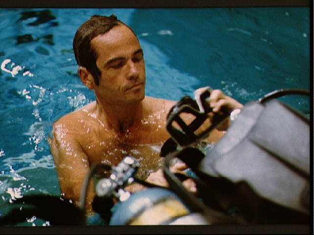 STS-41-G crew commander Crippen observes Preparations for Underwater EVA