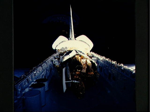Reflected view of the TDRS in the STS-6 Challengers payload bay