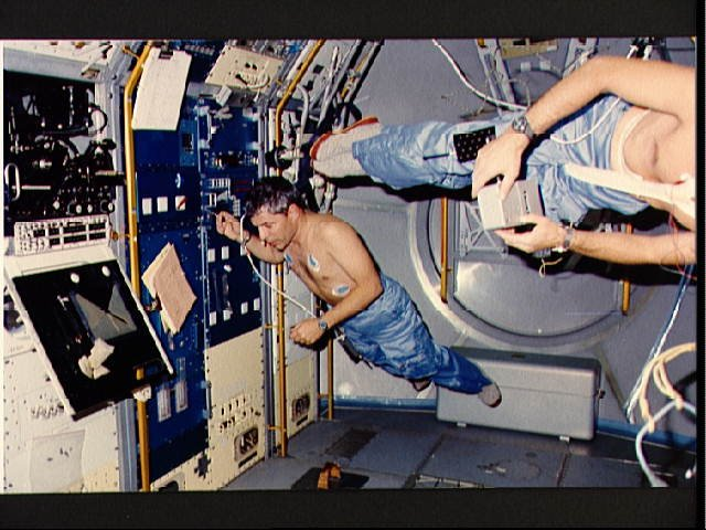 STS-9 crewmembers Parker and Merbold floating about the Spacelab module