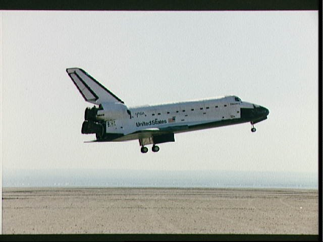 STS-26 Discovery, OV-103, with landing gear deployed glides above EAFB runway